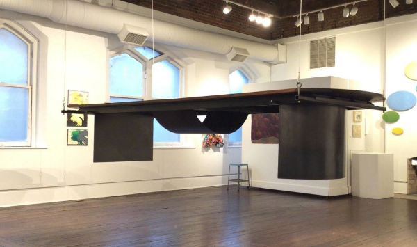 Osborn designed and crafted the Harrison Gallery's descending table.