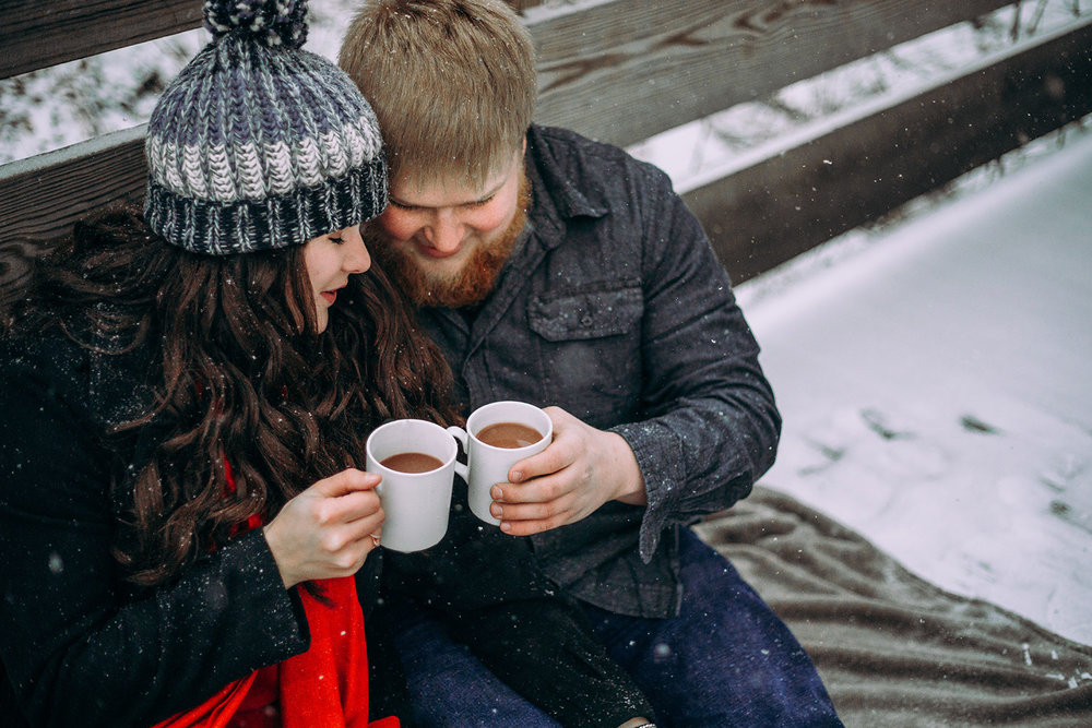 Shutter Up Studios | Engagement photographer in West Lafayette Indiana | Snowy winter couples photo session with hot chocolate mugs at Happy Hollow Park