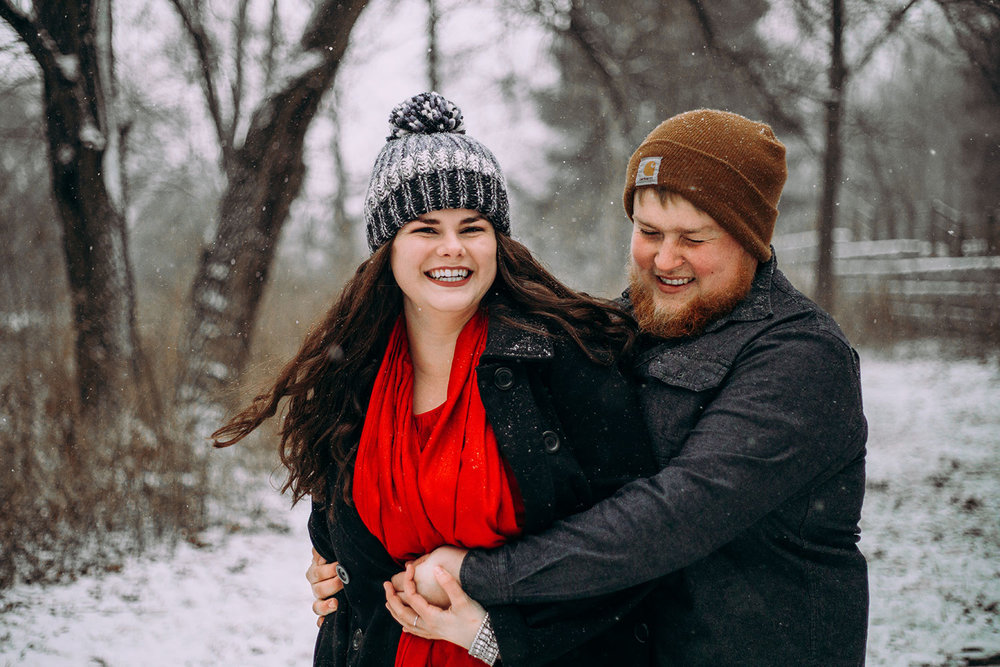 Shutter Up Studios | Engagement photographer in West Lafayette Indiana | Snowy winter couples candid photo session at Happy Hollow Park
