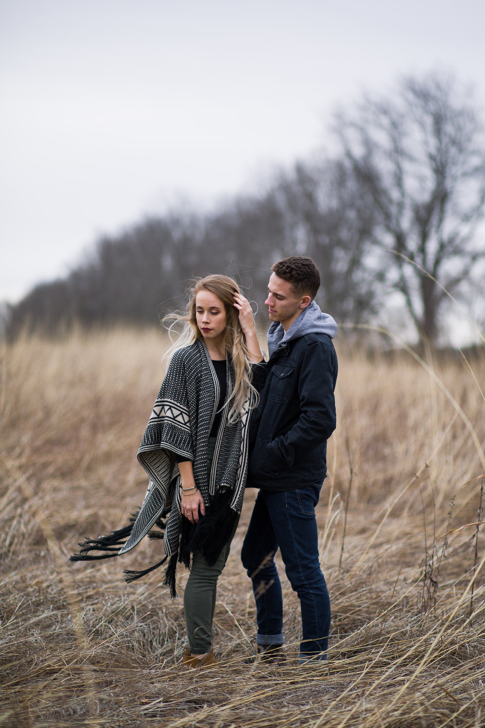 Shutter Up Studios | Engagement photographer in West Lafayette Indiana | Windy couples photo session in a field at Prophetstown State Park