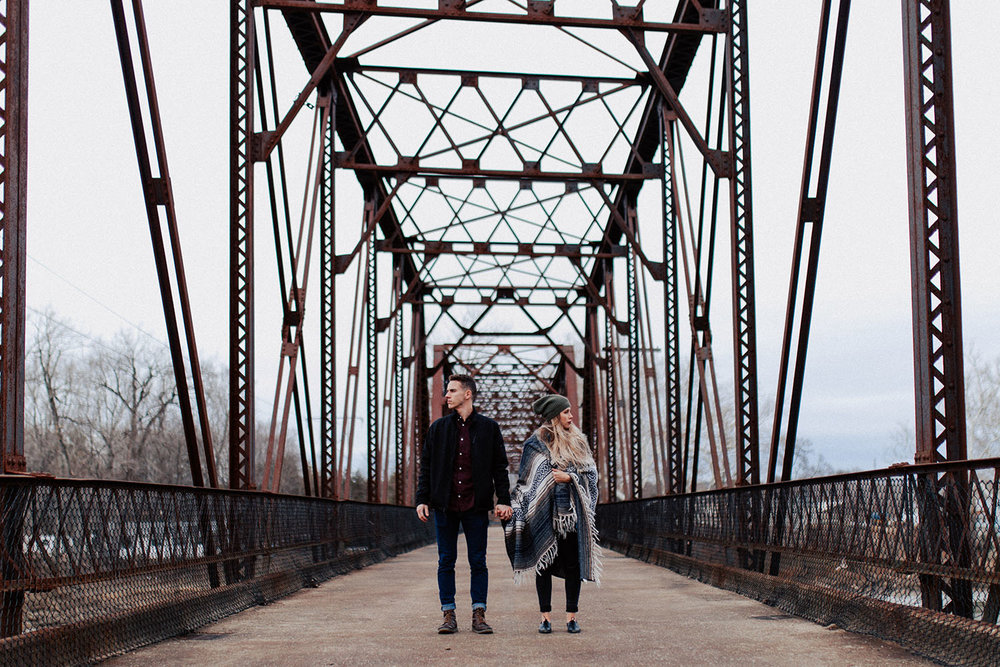 Shutter Up Studios | Engagement photographer in West Lafayette Indiana | Fall winter couples photo session at the Wabash Heritage Trail bridge at Davis Ferry Park