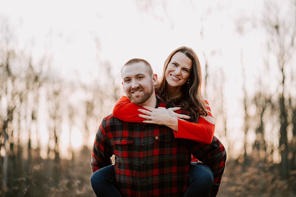 Shutter Up Studios | Wedding photographer in Crawfordsville Indiana | Sunset engagement session with red flannel and piggyback ride
