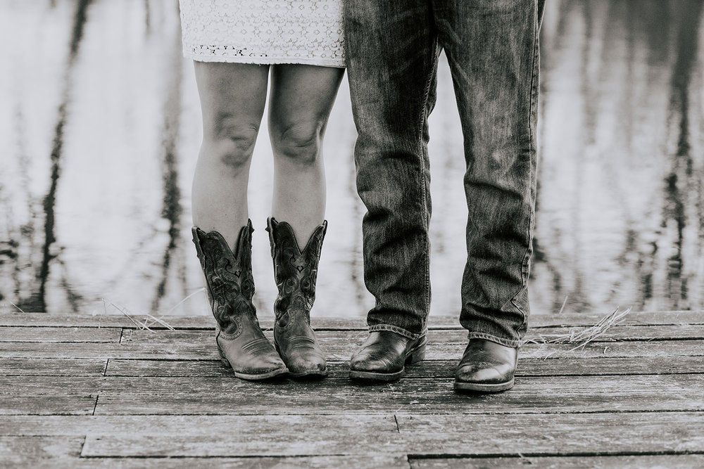 Shutter Up Studios | Wedding photographer in Crawfordsville Indiana | Black and white engagement session at the lake with cowboy boots