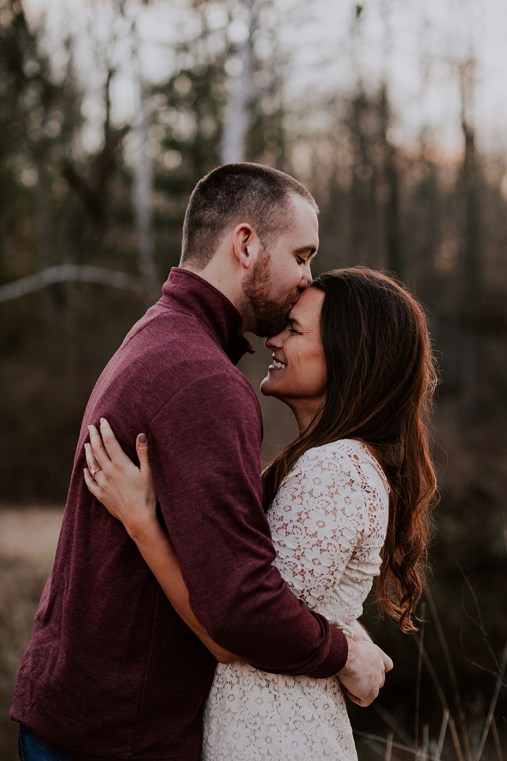 Shutter Up Studios | Wedding photographer in Crawfordsville Indiana | Sunset engagement session with white lace dress and forehead kiss