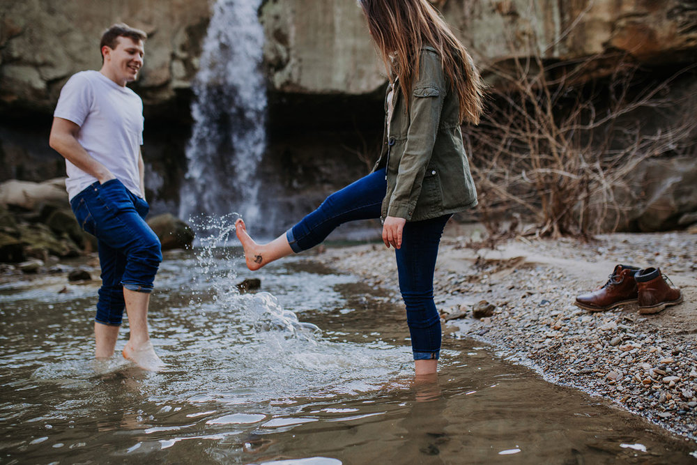 Shutter Up Studios | Engagement photographer in Williamsport Indiana | Barefoot couples session splashing in the river at Williamsport Falls waterfall