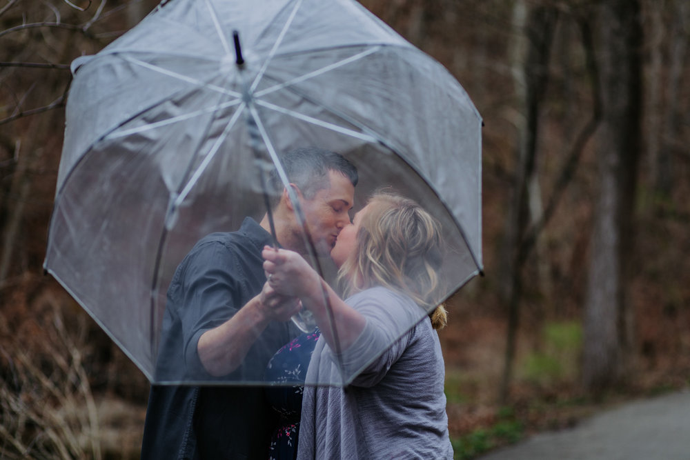 Shutter Up Studios   Engagement photographer in West Lafayette, Indiana   Rainy day couple with clear umbrella at Happy Hollow Park
