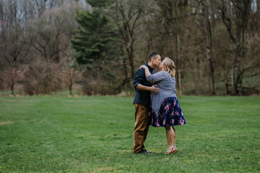 Shutter Up Studios   Engagement photographer in West Lafayette, Indiana   Cloudy day couple in field at Happy Hollow Park