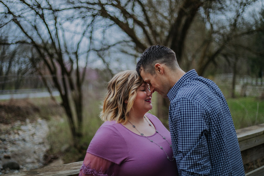 Shutter Up Studios   Engagement photographer in West Lafayette, Indiana   Cloudy day couple foreheads together at Happy Hollow Park