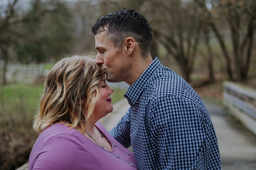 Shutter Up Studios   Engagement photographer in West Lafayette, Indiana   Cloudy day couple forehead kiss at Happy Hollow Park