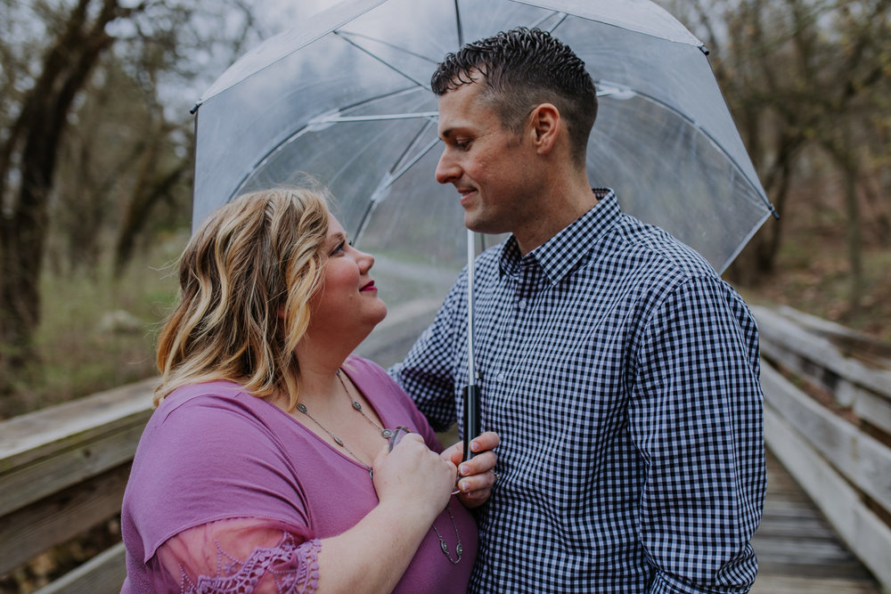 Shutter Up Studios   Engagement photographer in West Lafayette, Indiana   Rain couple with clear umbrella at Happy Hollow Park