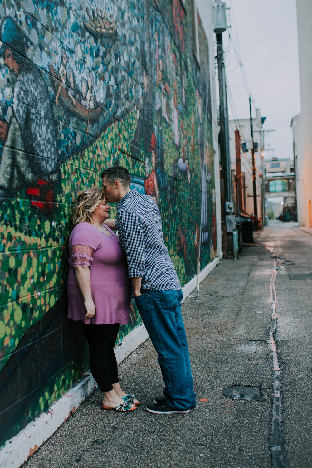 """Shutter Up Studios   Engagement photographer in Lafayette, Indiana   Couple with colorful mural downtown after Georges Seurat's """"A Sunday on La Grande Jatte"""""""