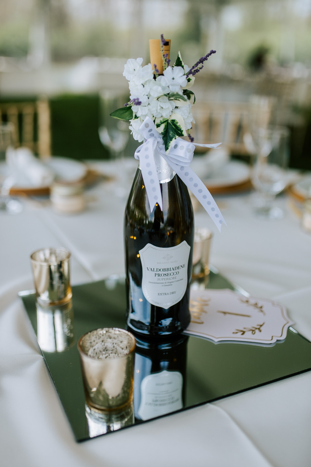 Shutter Up Studios   Wedding photographer in Pittsburgh, Pennsylvania   Floral country chic reception wine bottle centerpiece