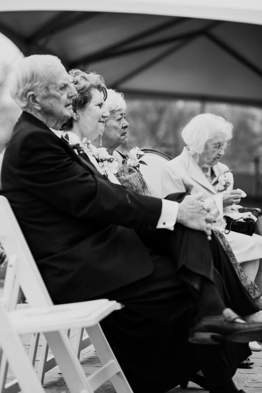 Shutter Up Studios   Wedding photographer in Pittsburgh, Pennsylvania   Black and white photo of grandparents at ceremony