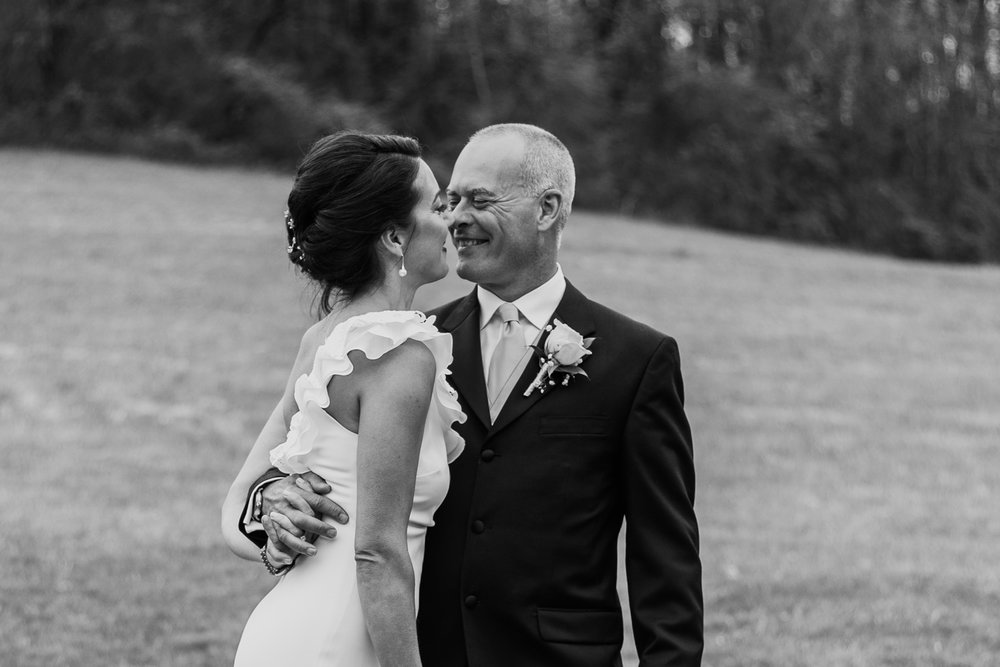 Shutter Up Studios   Wedding photographer in Pittsburgh, Pennsylvania   Bride and groom in field in black and white