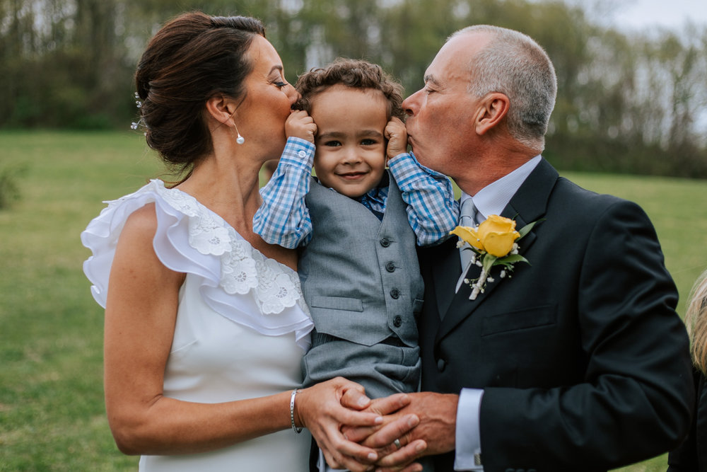 Shutter Up Studios   Wedding photographer in Pittsburgh, Pennsylvania   Bride and groom formal portrait with ring bearer
