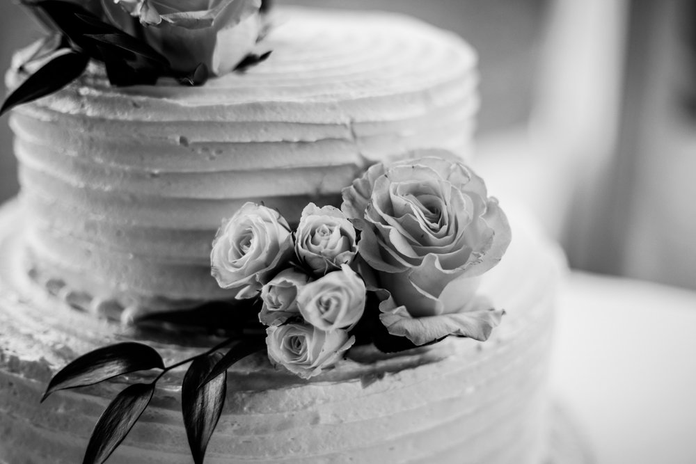 Shutter Up Studios   Wedding photographer in Pittsburgh, Pennsylvania   Black and white wedding cake from Kretchmar's Bakery with roses