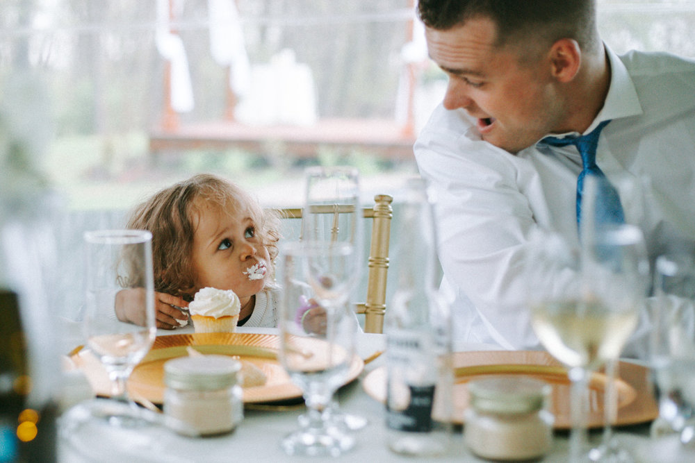 Shutter Up Studios   Wedding photographer in Pittsburgh, Pennsylvania   Flower girl with cupcake and frosting icing on face