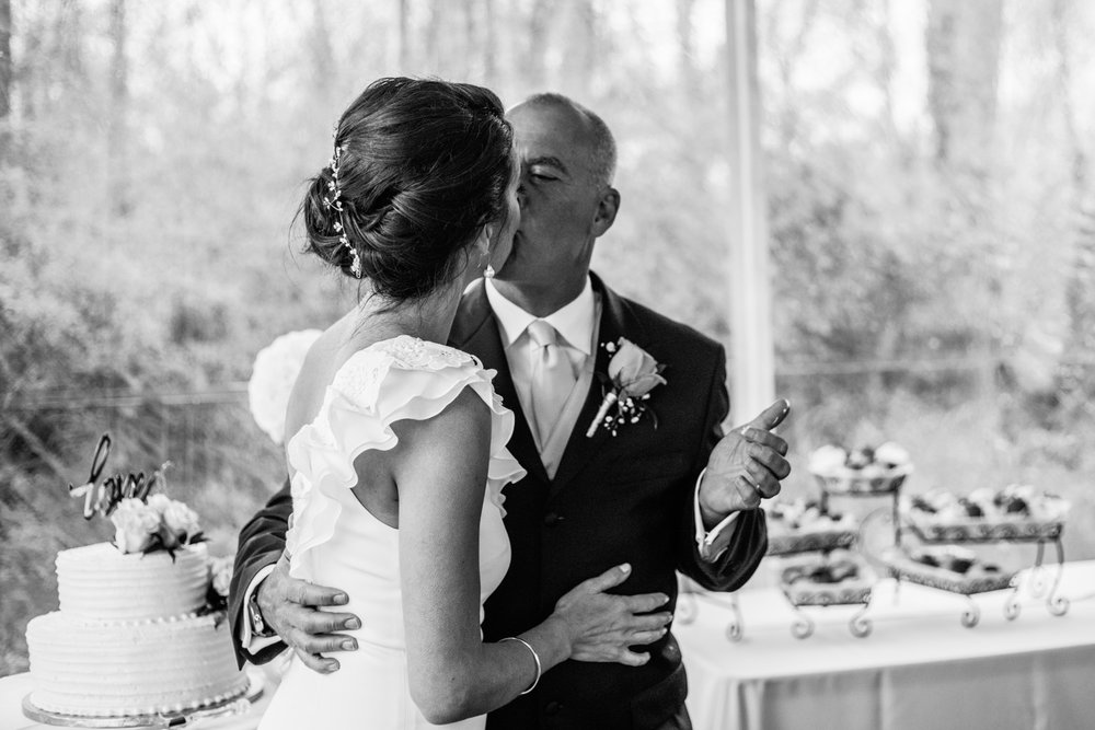 Shutter Up Studios   Wedding photographer in Pittsburgh, Pennsylvania   Bride and groom cake cutting in black and white