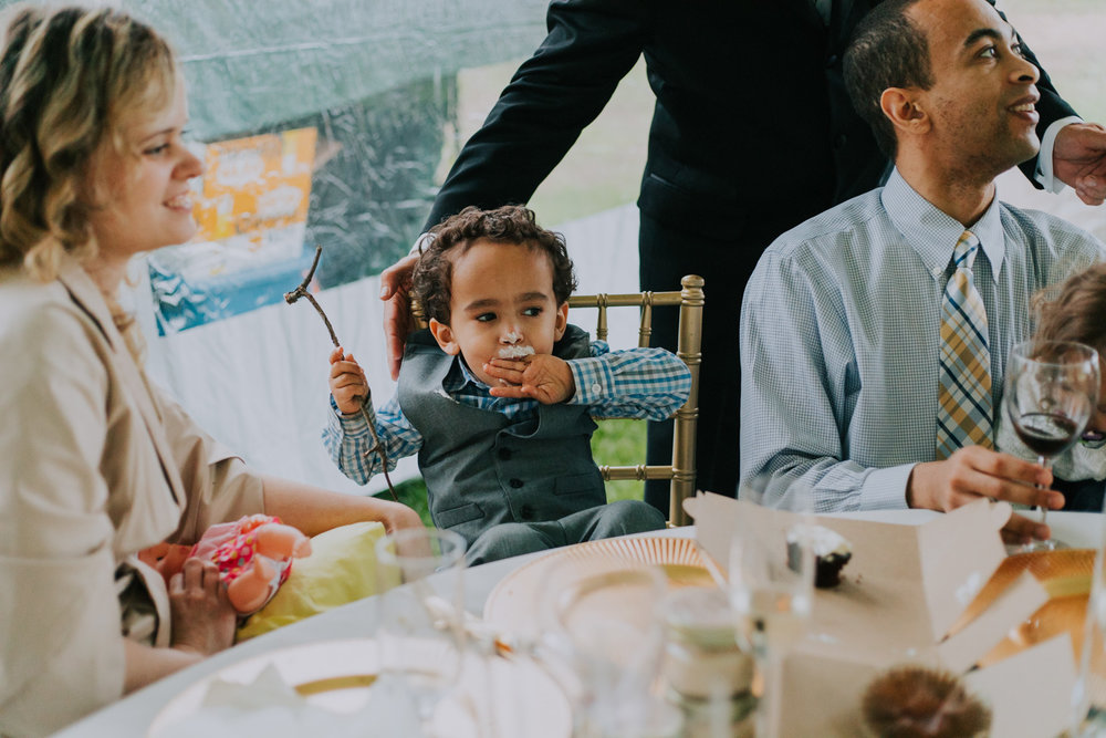 Shutter Up Studios   Wedding photographer in Pittsburgh, Pennsylvania   Ring bearer eating cupcake with frosting icing on face
