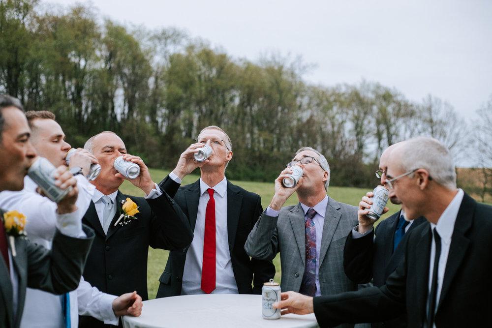 Shutter Up Studios   Wedding photographer in Pittsburgh, Pennsylvania   Groomsmen beer toast to grandpa and groom's dad