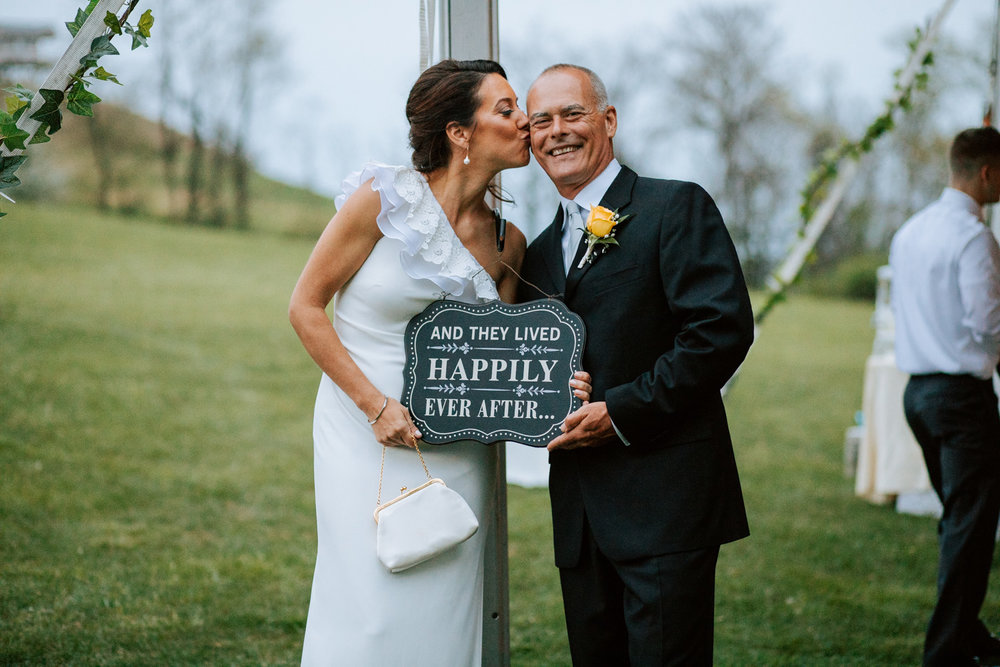 Shutter Up Studios   Wedding photographer in Pittsburgh, Pennsylvania   Bride and groom with happily ever after sign