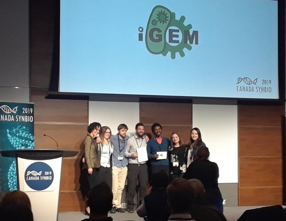University of Guelph iGEM Team accepting first place for the poster competition.  (Photo by Nathan Braniff)