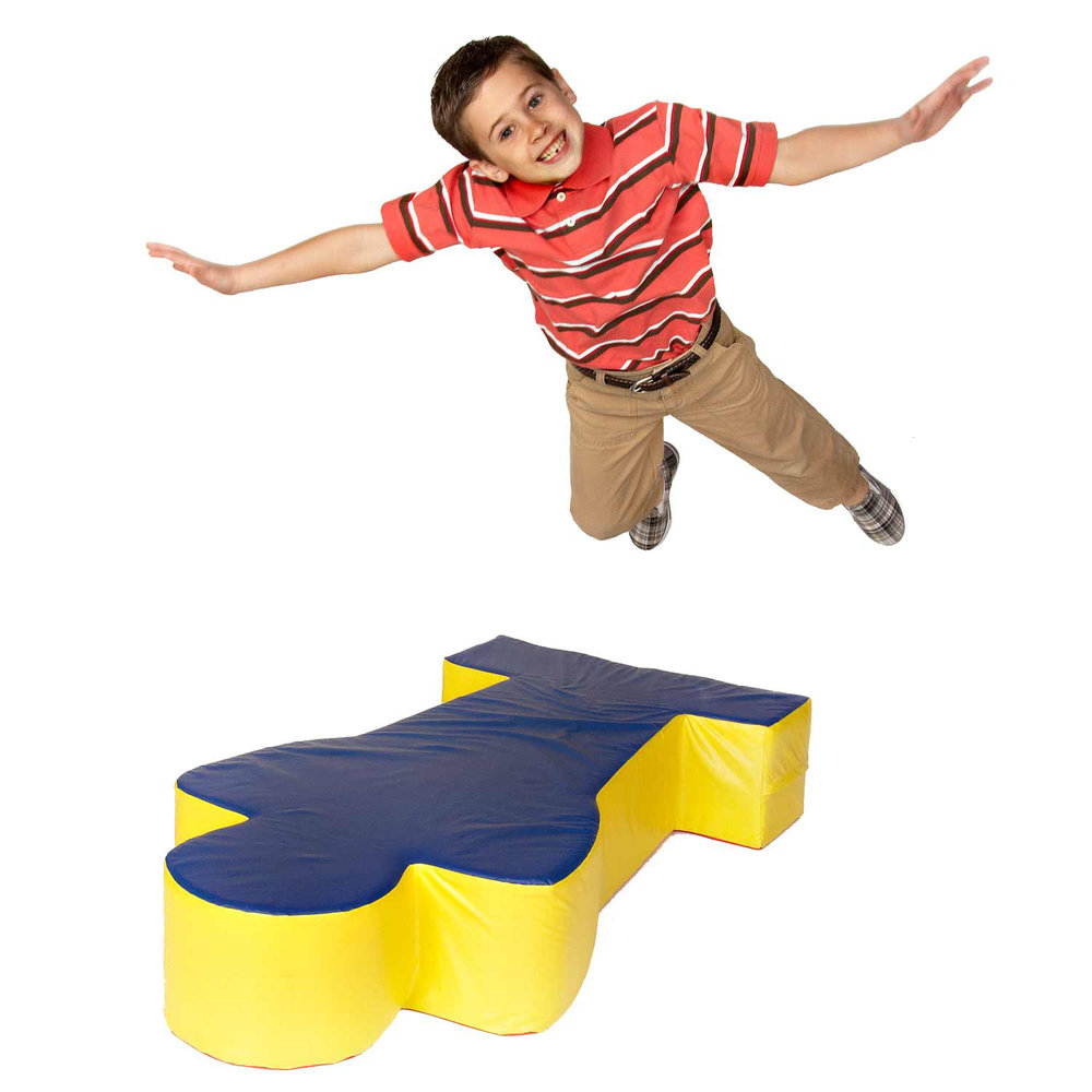 Boy jumping on a Foam Man. Foamasium Foam Playsets & Playroom Furniture make it possible for your child to play rough and play safe.