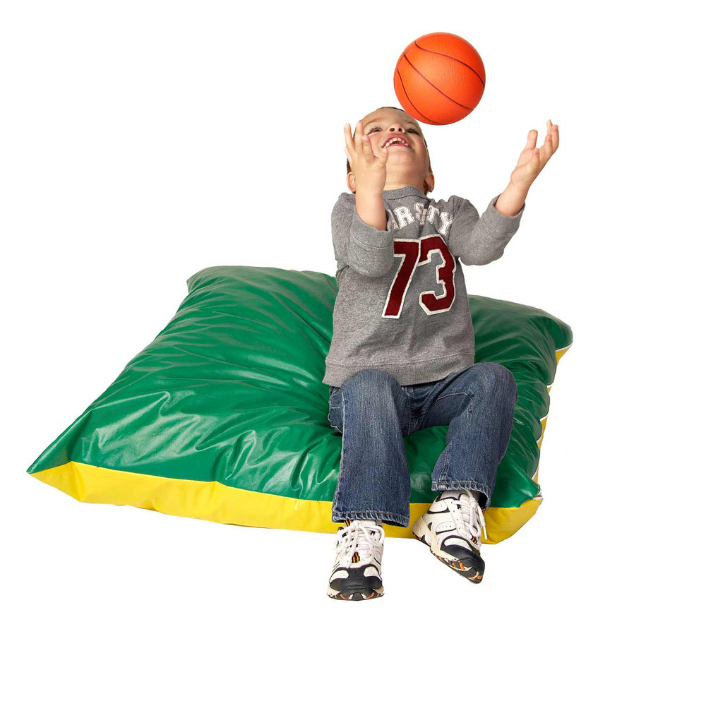 Boy playing with ball on Foamnasium foam floor pillow.