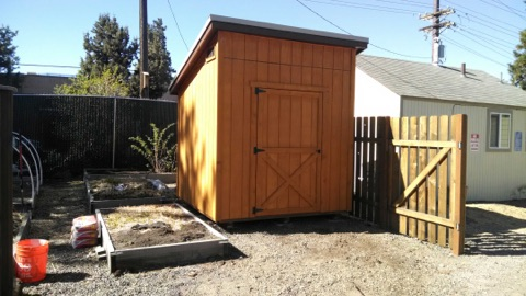 St. Vincent DePaul needed a bit of extra storage space. We build a functional (while still cute) space for them to maximize their storage.  The stained T1-11 siding, shed roof, and barn door entrance this shed reaches the fullest potential for storage as well as aesthetics.