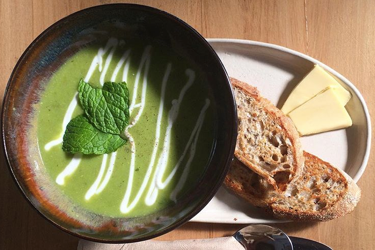Grizzly Country Sourdough accompanying Kadett Cafe's beautiful green soup