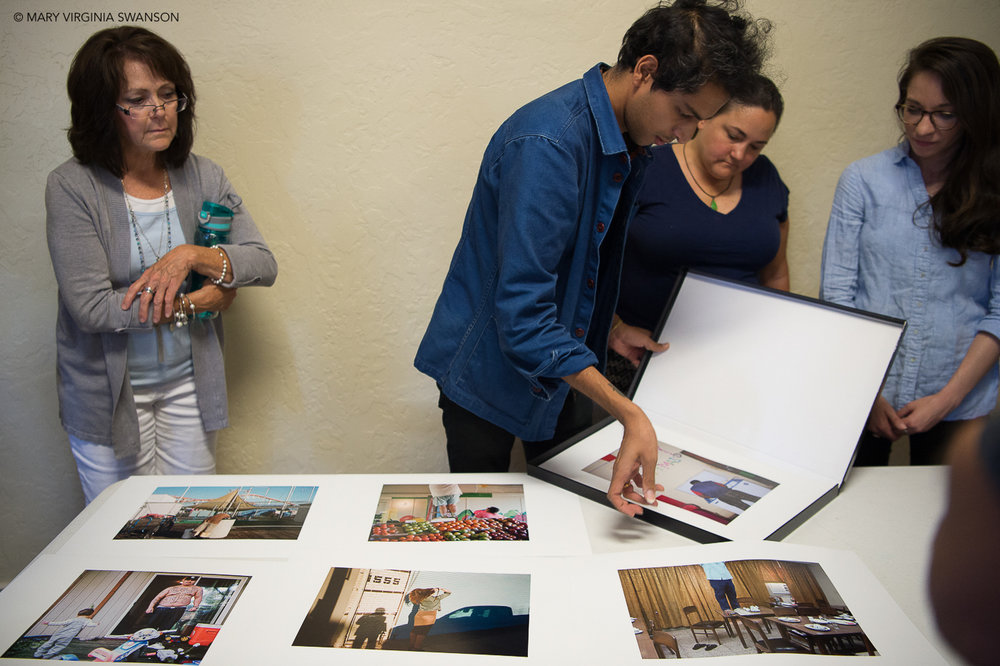 Photographer Vikesh Kapoor is laying out a selection of his images at the Estrin workshop at CUNY, New York City
