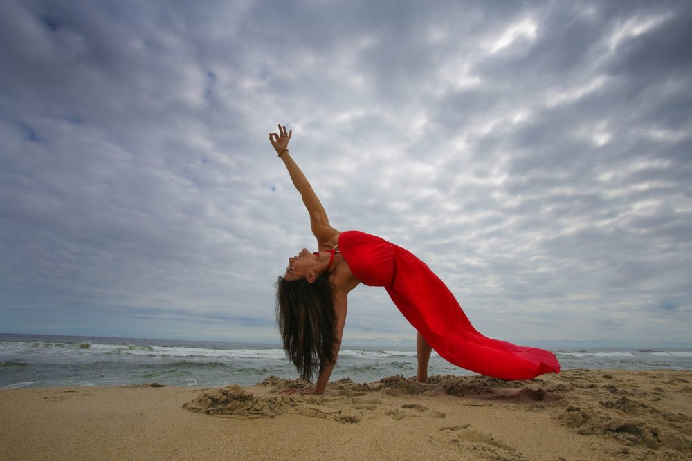 Robert Sturman photograph of a yoga pose on a beach