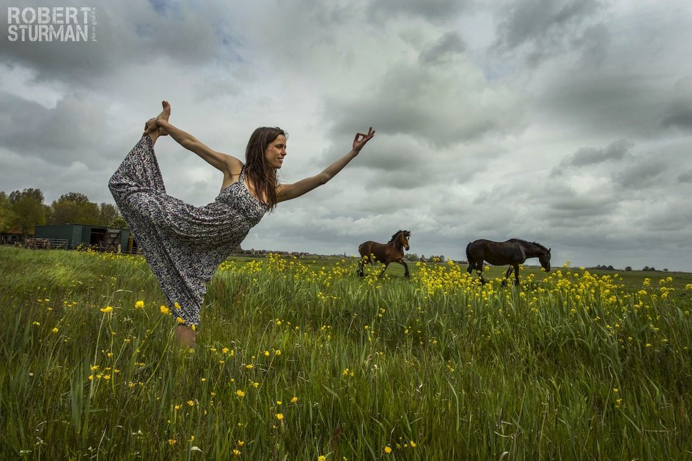 Robert Sturman photography of a woman doing yoga in a field