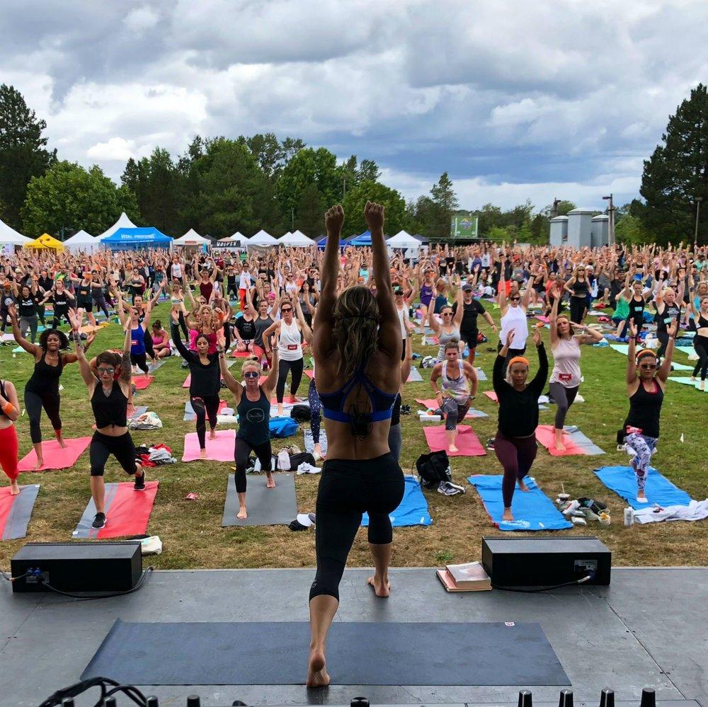 Chelsey Korus leading group yoga outdoors