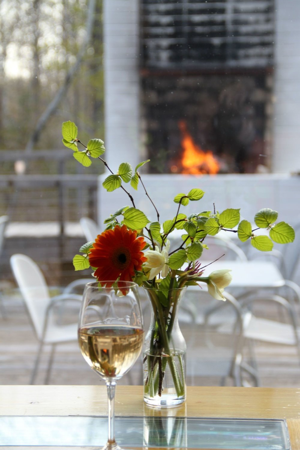 Flower beside a glass of wine in the bar at Wild Rice Retreat