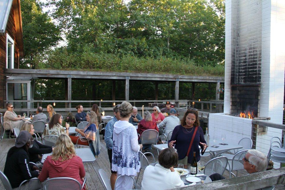 Crowd at a Wine Bar event at Wild Rice Retreat