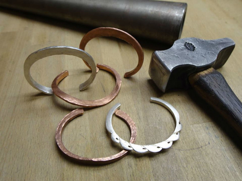 Forged bracelets by Michael Sturlin