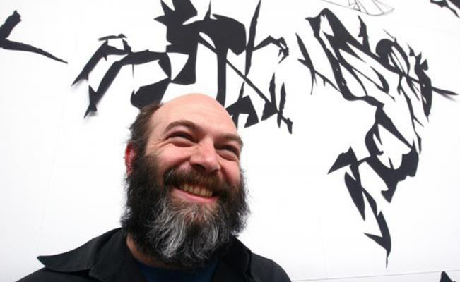 Above: Artist Carlos Amorales with his work  Black Cloud