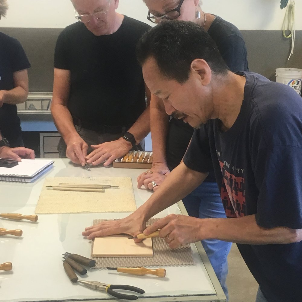 Carving the ukiyo-e block.