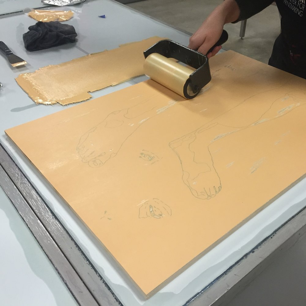 Rolling ink onto relief block.