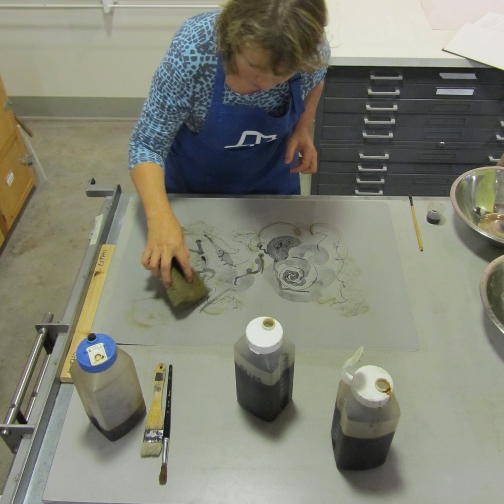Etching a ball-grained plate.