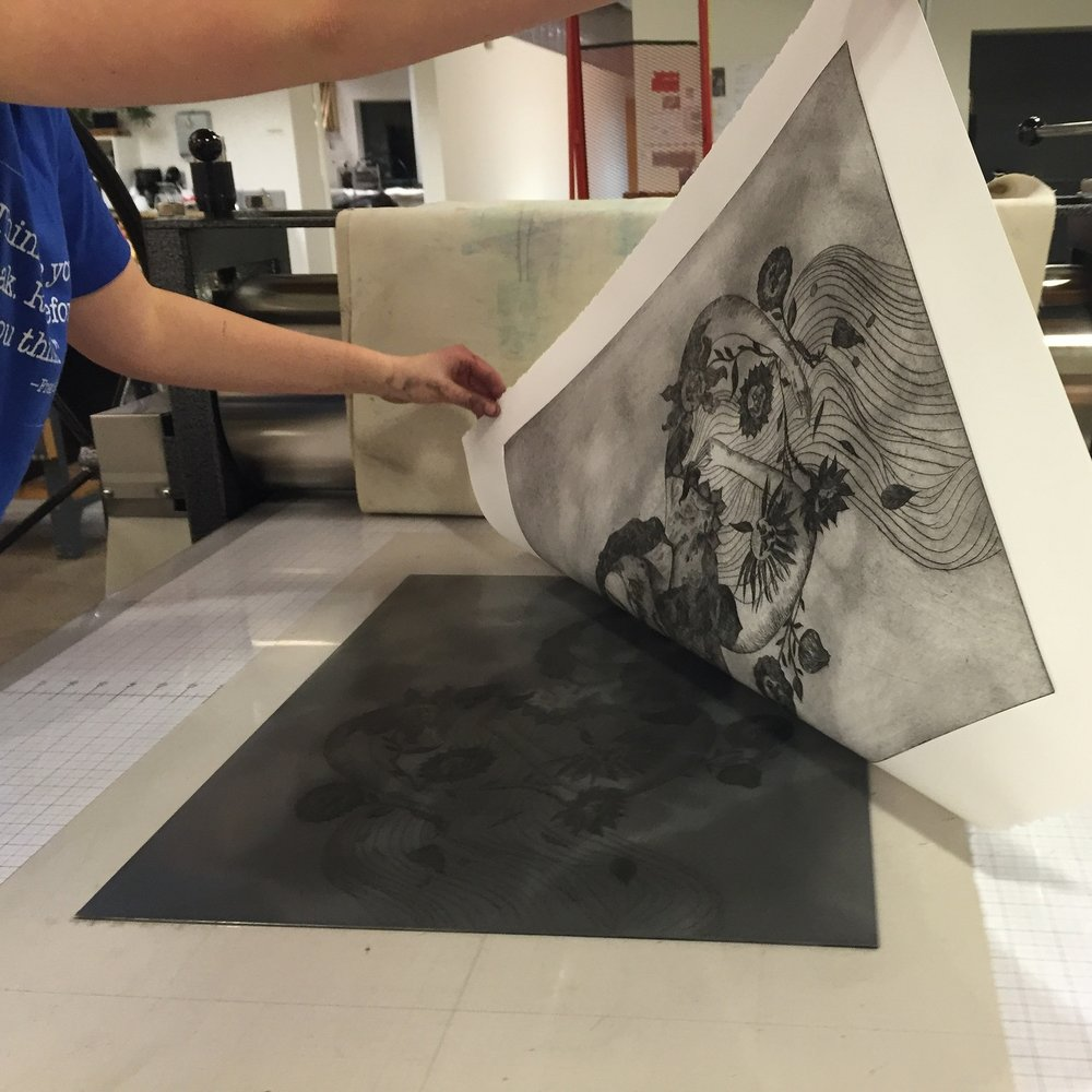 Pulling the printed sheet off of the plate.