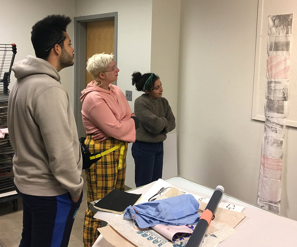 Left to right: Connor Rice, Nancy Hicks, and Lamia Abukhadra during a critique.