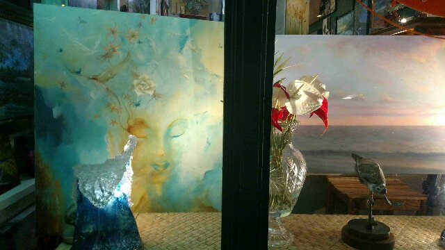 Dina's work in the window at Dreams Of Paradise Gallery on historic Hilo Bay in Hawaii