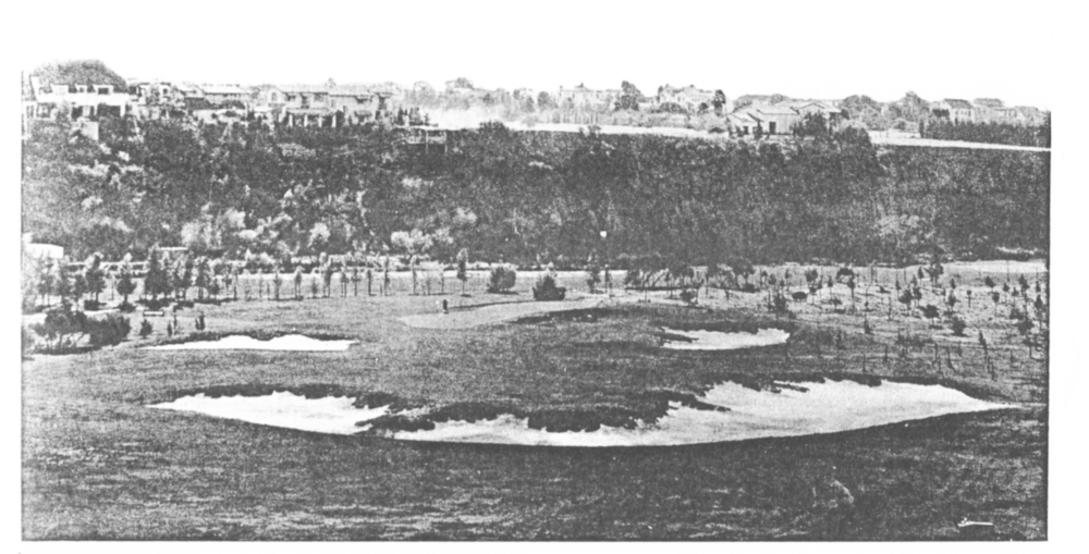 "The 10th hole as bunkers are added around the green in 1928. The left ""lay-up"" bunker had also been recently installed. The two foreground bunkers and far right bunker were part of the original design."