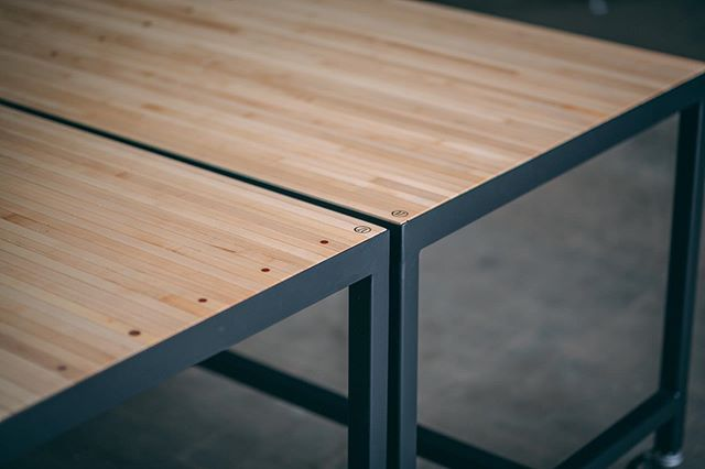 The client acquired these old sections of a bowling alley and asked us to make them some rolling bar height desks/community tables. Here is a little detail shot of the end product. The contrast between the maple and matte black powder coat is muy bueno