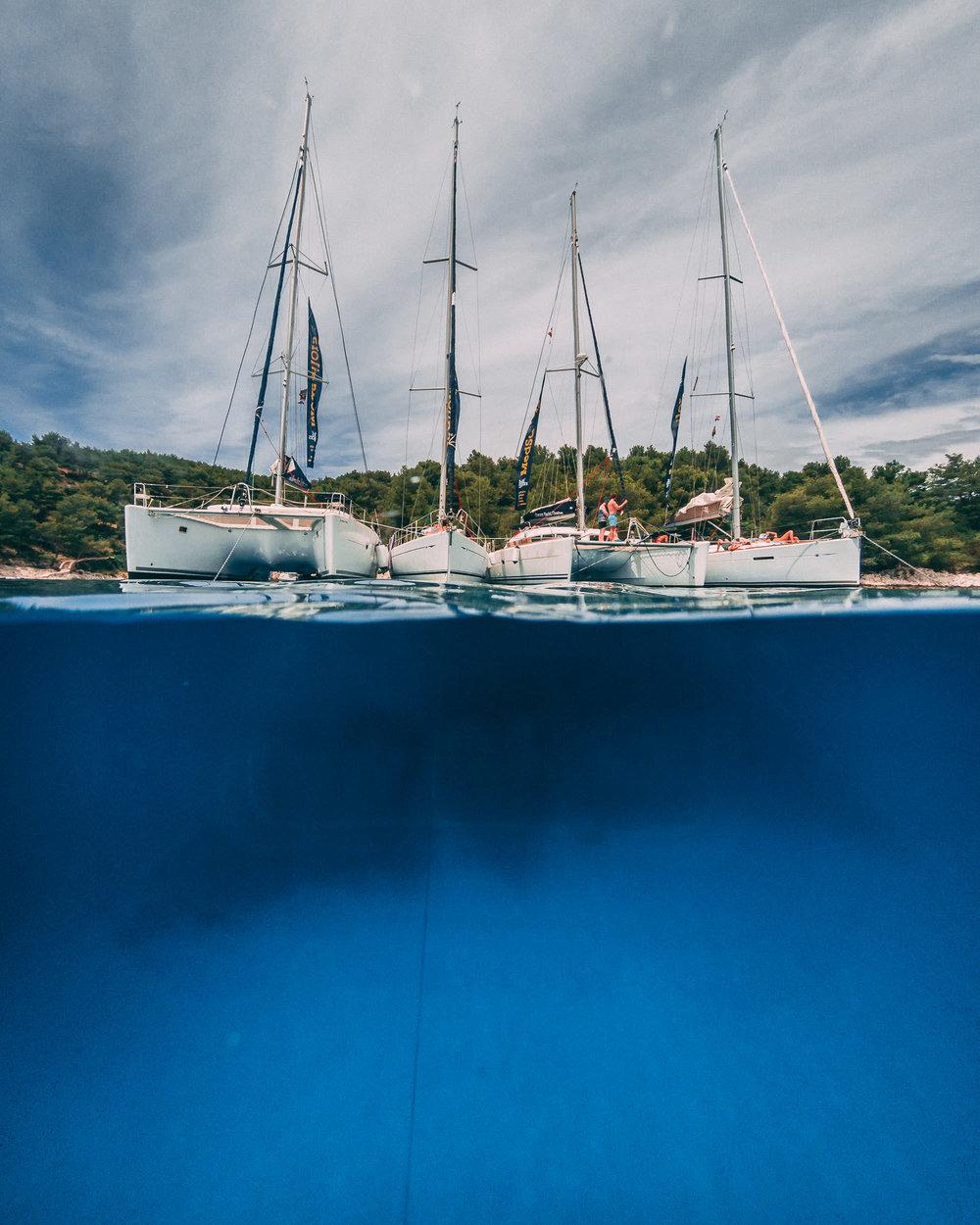 Tying our yachts together to create a raft on the coast of Hvar Island, Croatia