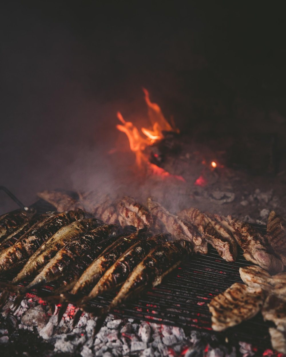 Chefs prepare a seafood BBQ for us at a remote location on Hvar, while sailing along the Mediterranean Coast