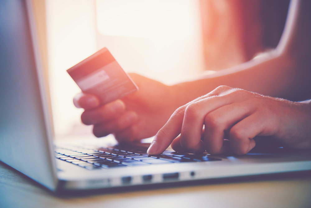 Copy of Copy of Copy of Copy of Hands holding credit card and using laptop. Online shopping