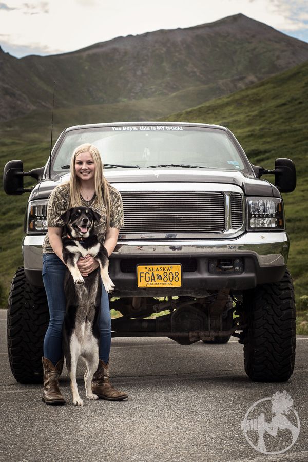 A girl, her truck and her dog